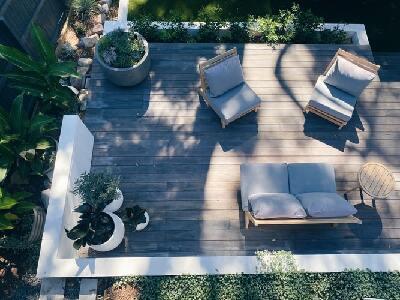 Backyard furniture on an improved wooden deck